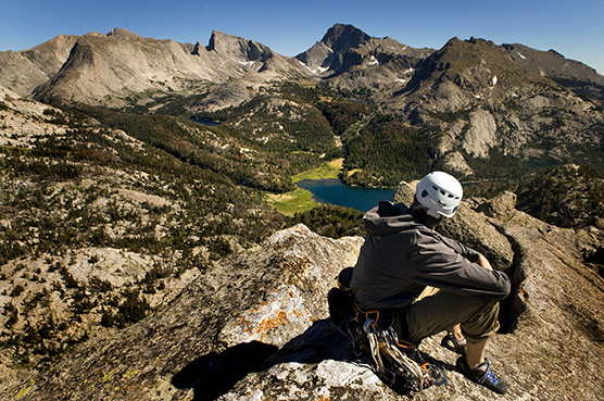 Wesley Gooch enjoying the views from the summit of Sundance Pinnacle near the Cirque of the Towers. Photo by Jed Conklin.